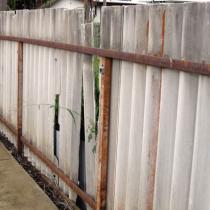 Corrugated asbestos fence