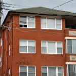 Australian Block of Flats - asbestos may be found under eaves, in bathrooms, laundries, kitchens and under flooring (carpet underlay, vinyl tiles or sheeting, wall and floor tiles), and electrical power boxes etc.