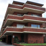 Australian Block of Flats - asbestos may be found under eaves, in bathrooms, laundries, kitchens and under flooring (carpet underlay, vinyl tiles or sheeting, wall and floor tiles), roofing and electrical power boxes etc.